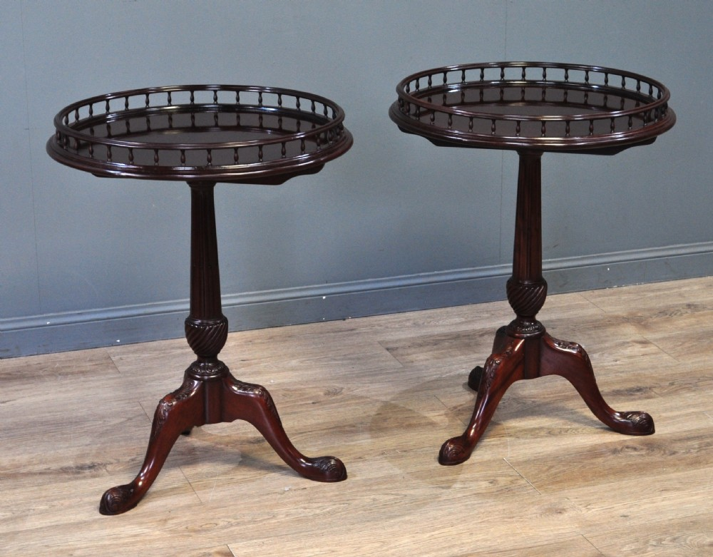 attractive pair of two antique style mahogany tilt top gallery edge side tables